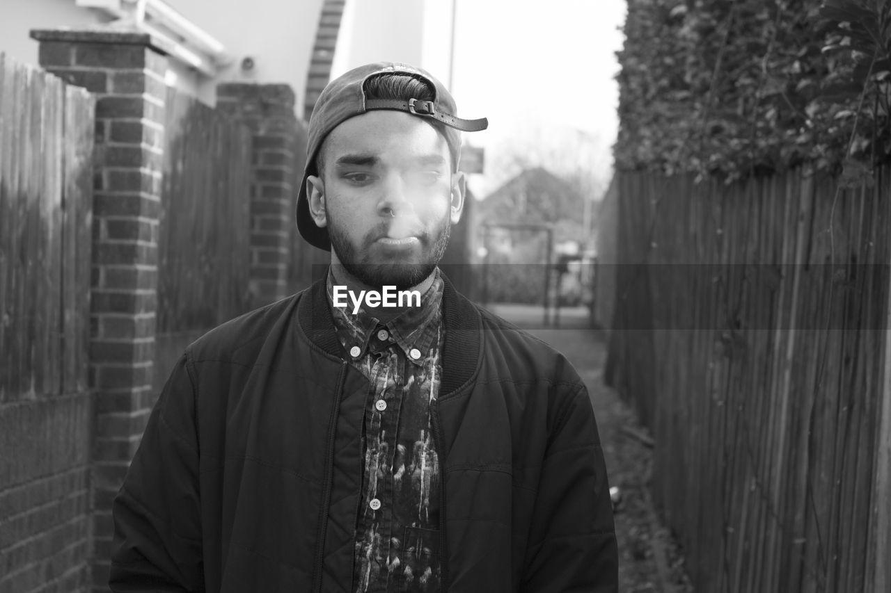 Man Blowing Smoke While Smoking