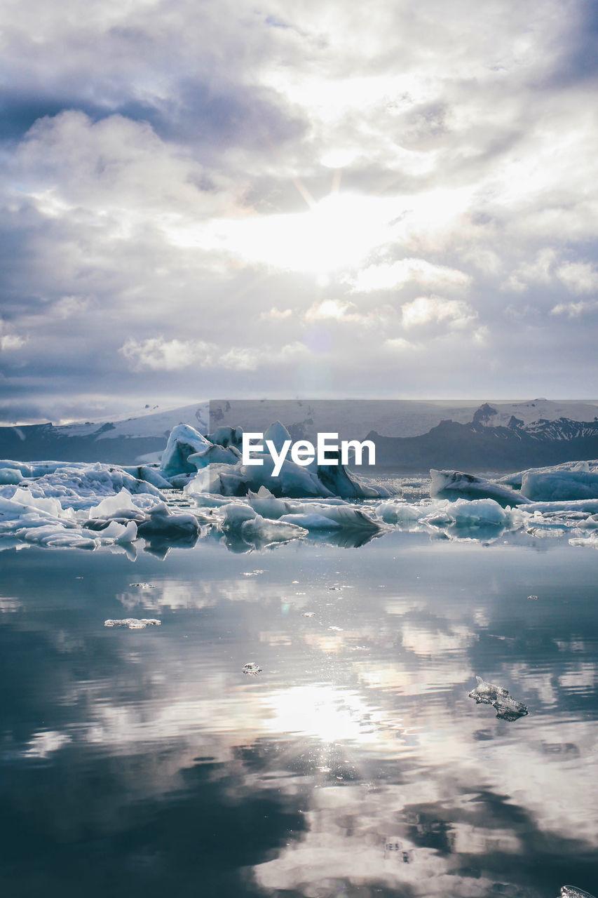 Iceberg Floating In River Against Sky