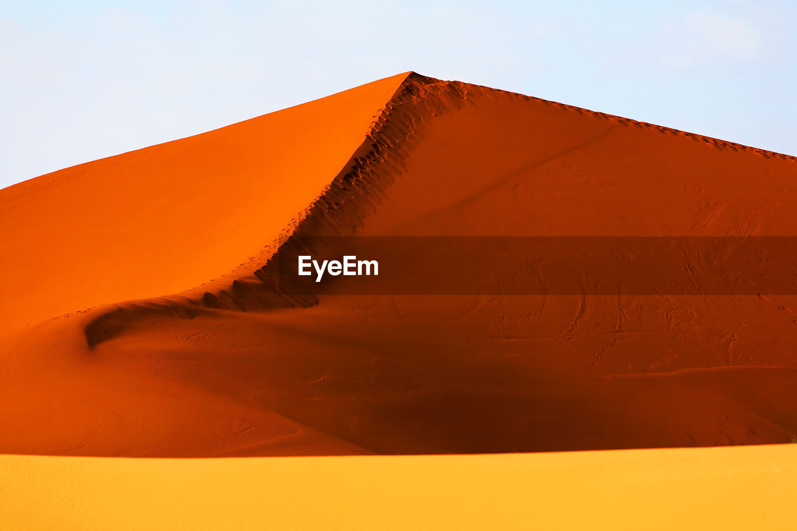 LOW ANGLE VIEW OF SAND DUNES AGAINST SKY
