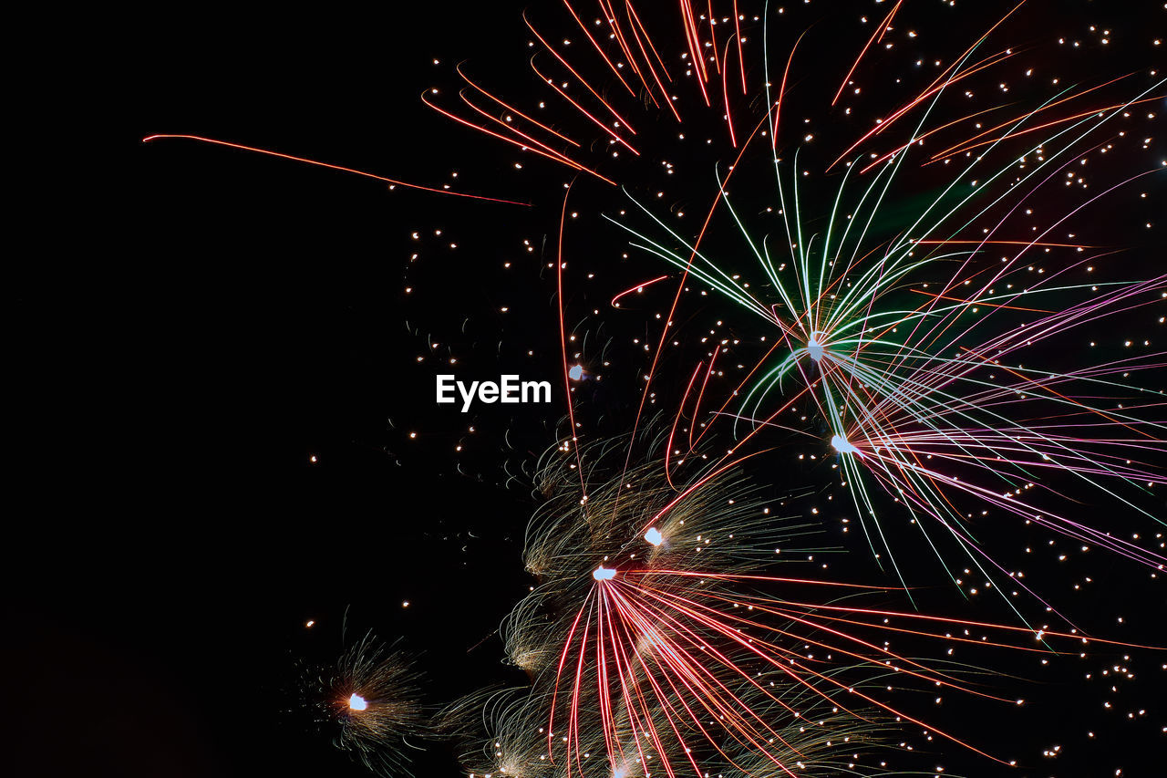 night, illuminated, firework display, long exposure, celebration, firework - man made object, motion, exploding, glowing, arts culture and entertainment, blurred motion, firework, event, no people, sparkler, multi colored, outdoors, clear sky, sky, black background