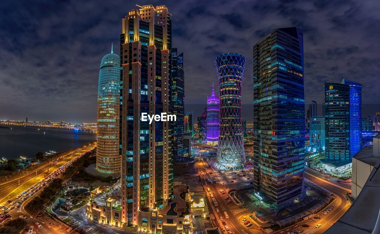 building exterior, architecture, built structure, city, building, illuminated, office building exterior, night, sky, modern, cityscape, tall - high, skyscraper, cloud - sky, tower, city life, office, nature, motion, long exposure, no people, outdoors, financial district