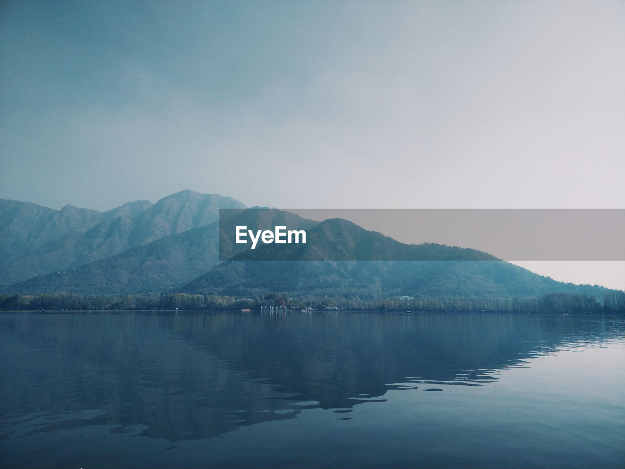mountain, sky, water, scenics - nature, beauty in nature, tranquility, tranquil scene, reflection, waterfront, mountain range, lake, nature, no people, day, copy space, non-urban scene, idyllic, clear sky, outdoors