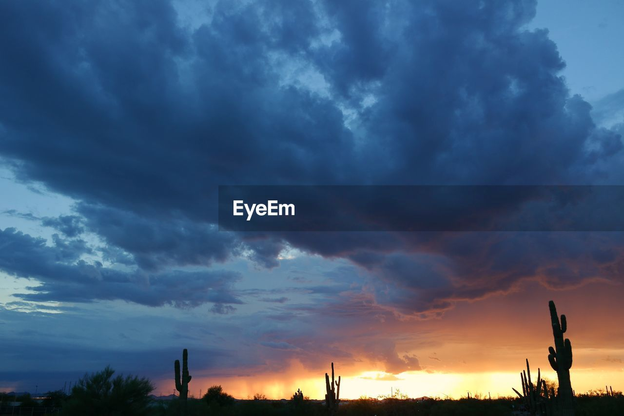 Scenic View Of Cloudy Sky Over Landscape During Sunset