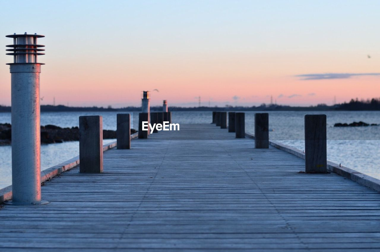 Wooden jetty leading to calm sea