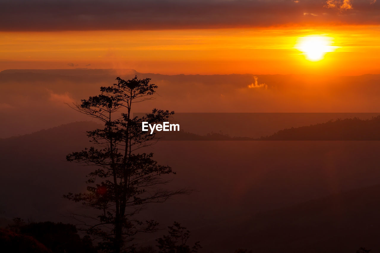 Scenic View Of Mountain During Sunrise
