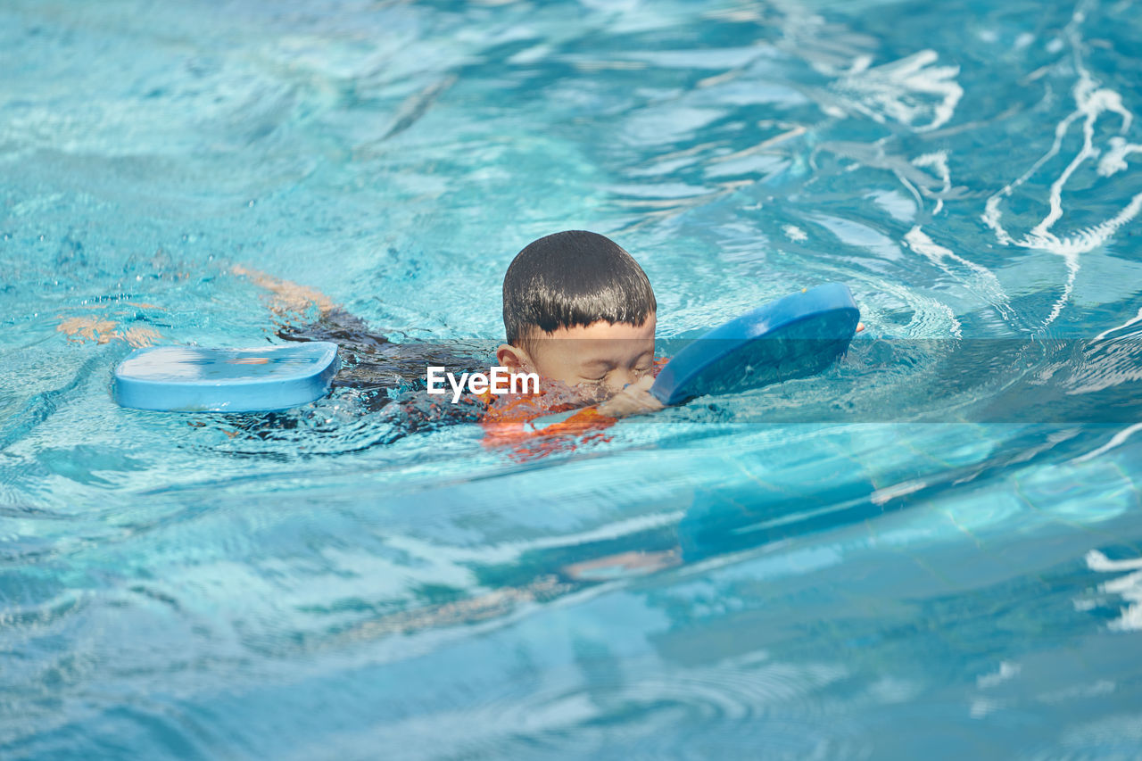 Boy swimming in pool