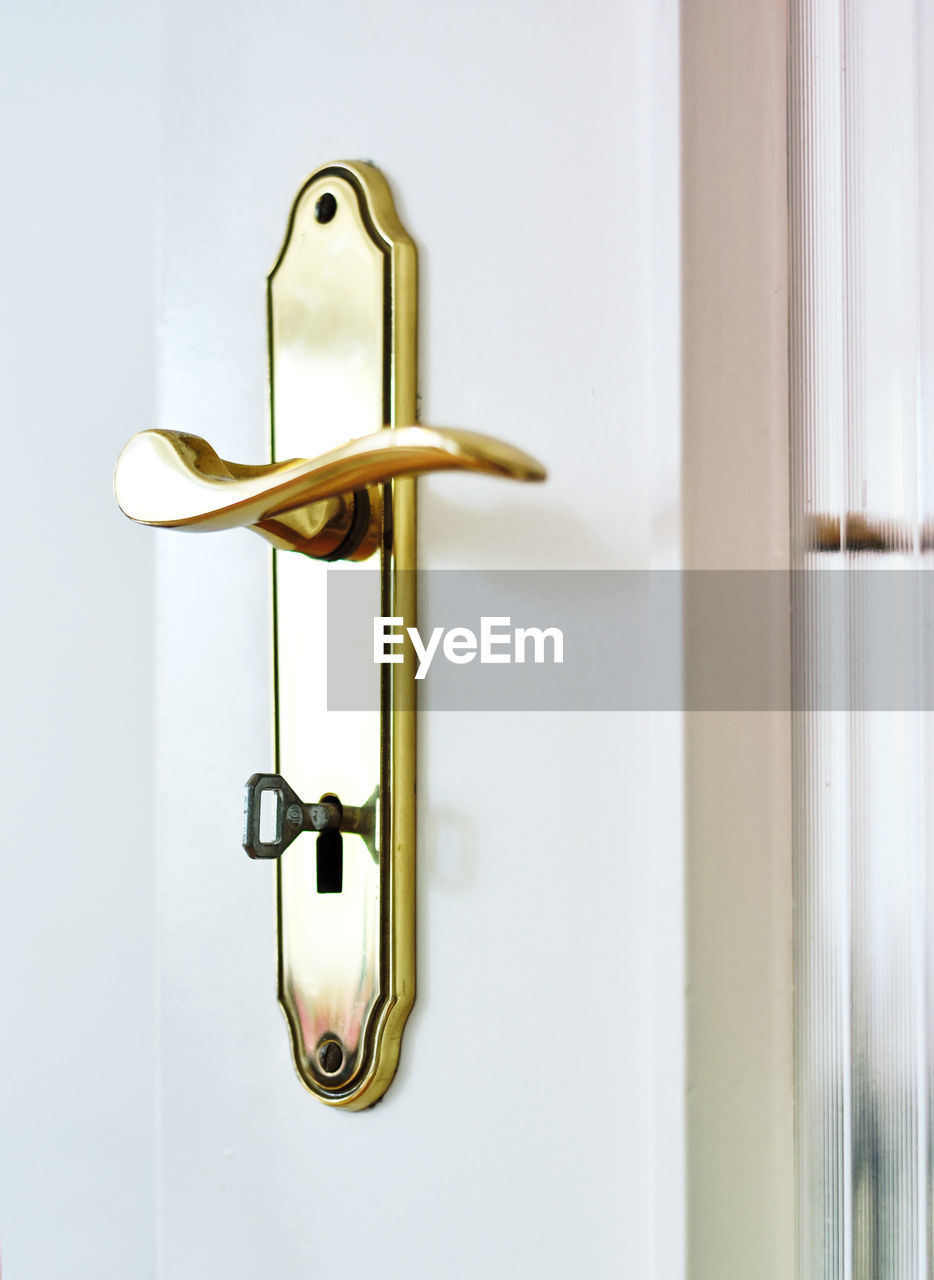 safety, door, entrance, security, metal, protection, gold colored, lock, no people, close-up, indoors, handle, doorknob, keyhole, key, knob, white color, hanging, wood - material, home interior, latch, silver colored