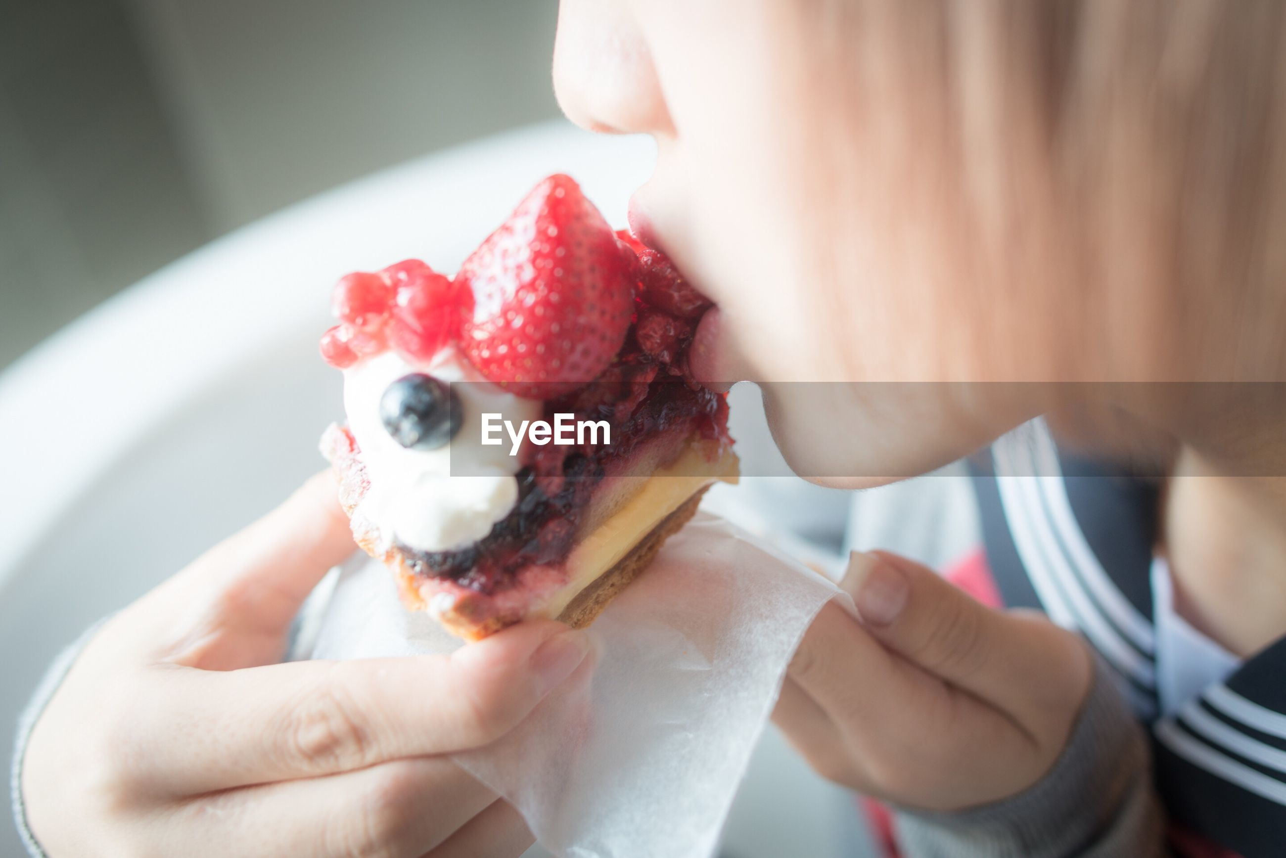 Midsection of woman eating dessert