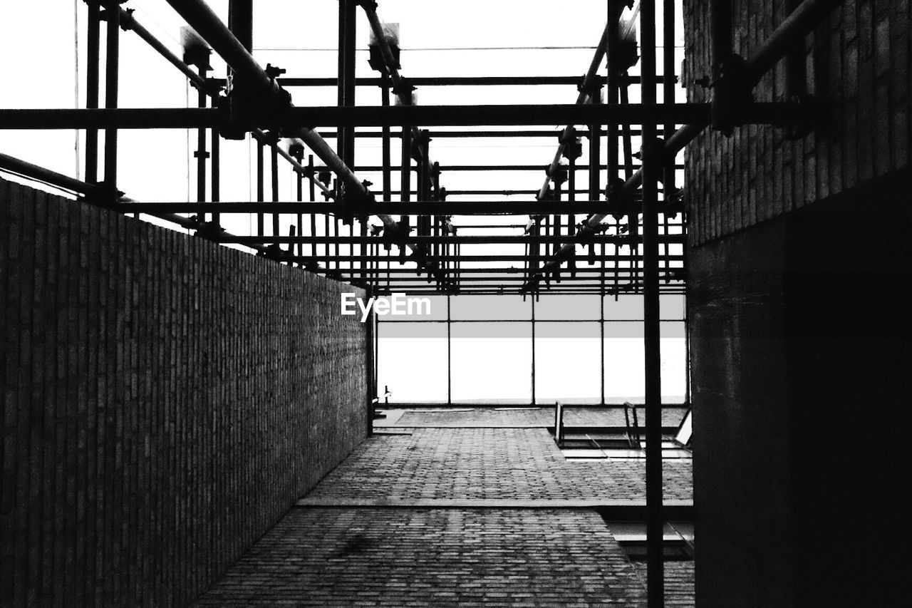 architecture, built structure, day, no people, wall - building feature, indoors, railing, building, metal, nature, the way forward, sky, window, direction, connection, wall, protection, pattern, security