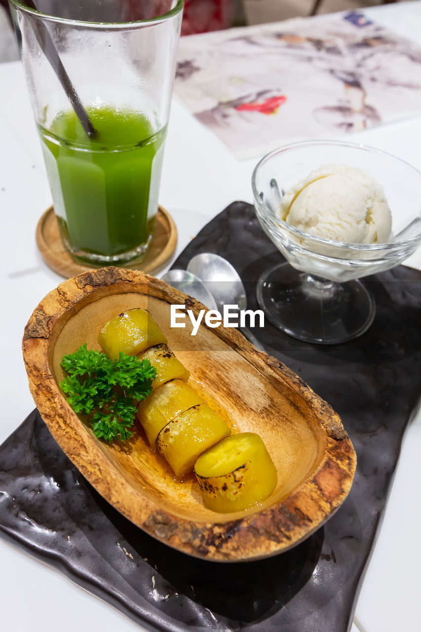 food and drink, food, freshness, ready-to-eat, drink, drinking glass, refreshment, glass, household equipment, table, no people, indoors, healthy eating, still life, serving size, high angle view, close-up, wellbeing, indulgence, eating utensil, temptation, garnish, crockery, mint leaf - culinary, tray