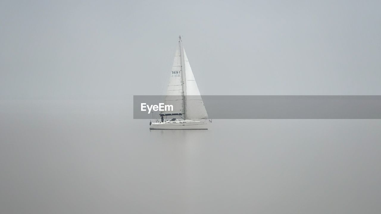 transportation, nautical vessel, copy space, mode of transportation, water, sailboat, no people, sea, sky, sailing, day, nature, architecture, beauty in nature, fog, direction, outdoors, building