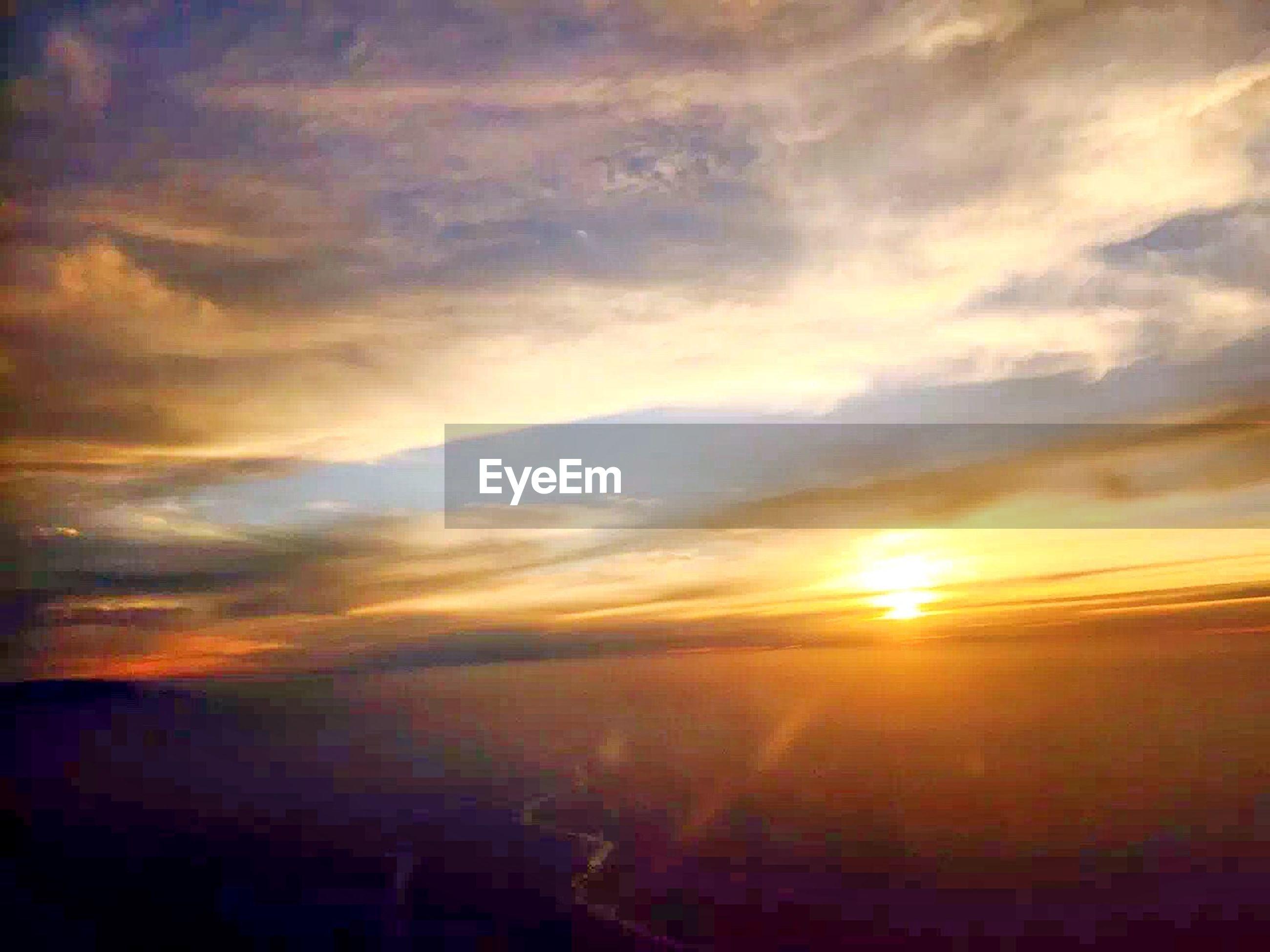 sunset, sky, orange color, cloud - sky, scenics, sun, beauty in nature, tranquil scene, tranquility, idyllic, nature, dramatic sky, cloudy, cloud, sunlight, silhouette, landscape, sunbeam, building exterior, weather