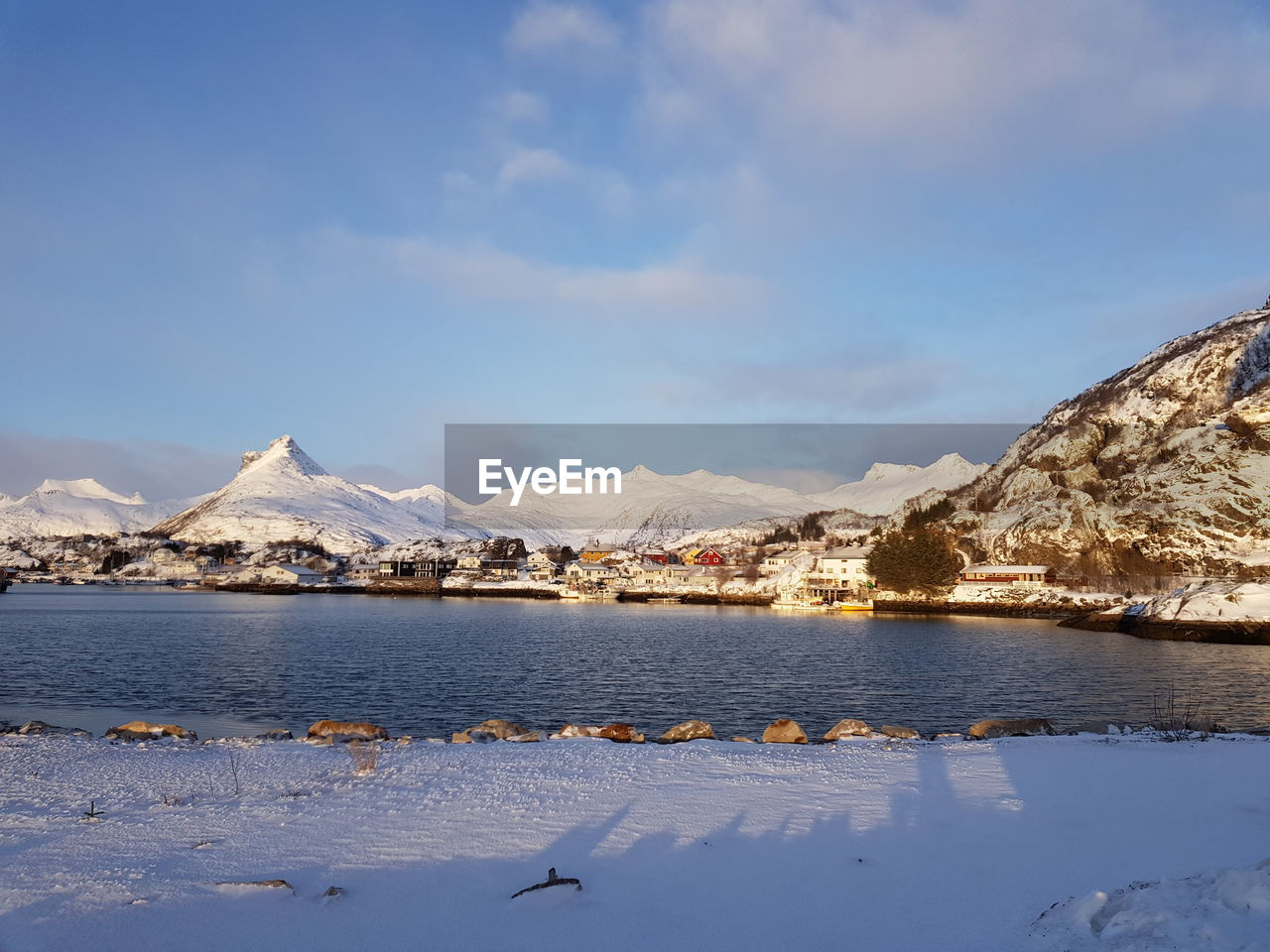 sky, mountain, water, cold temperature, snow, winter, scenics - nature, beauty in nature, nature, cloud - sky, architecture, no people, tranquil scene, tranquility, built structure, day, mountain range, building exterior, outdoors, snowcapped mountain