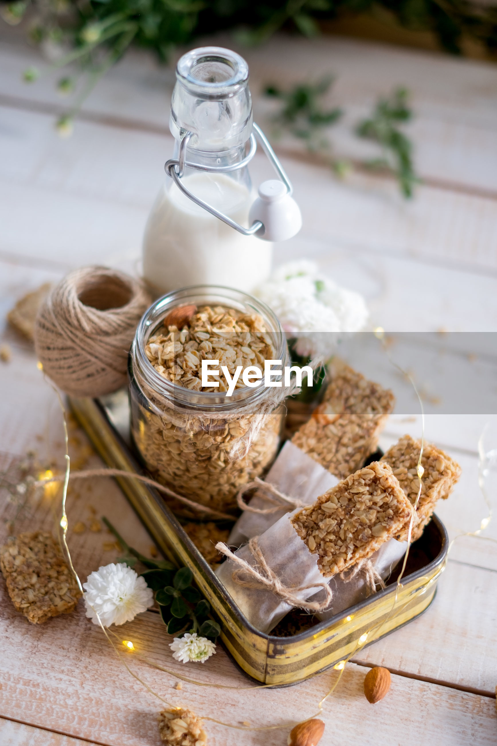 CLOSE-UP OF BREAKFAST IN GLASS CONTAINER ON TABLE
