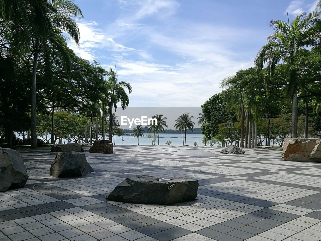 tree, sky, cloud - sky, palm tree, day, no people, outdoors, water, tourist resort, tranquility, sunlight, swimming pool, scenics, nature, travel destinations, luxury, vacations, architecture, beauty in nature