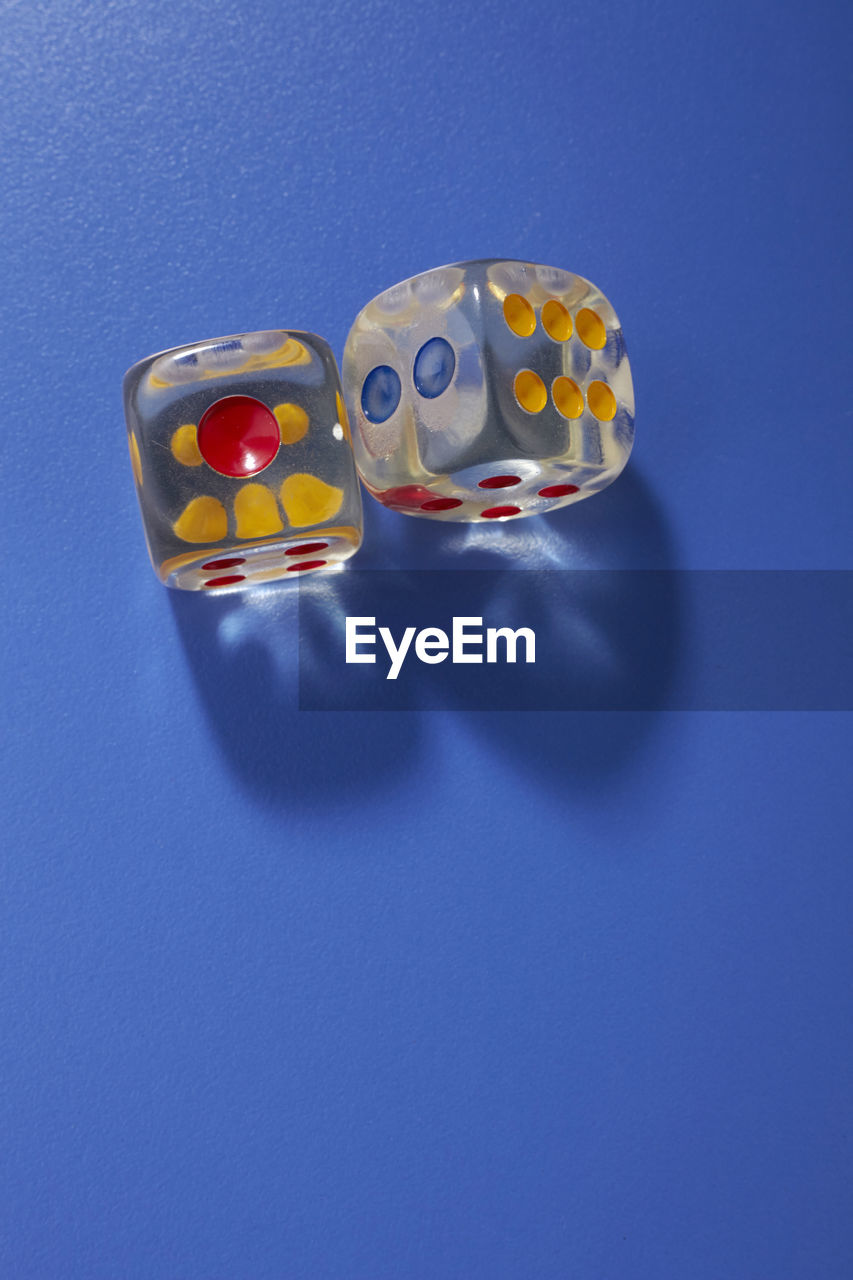 Close-up of dices on blue table