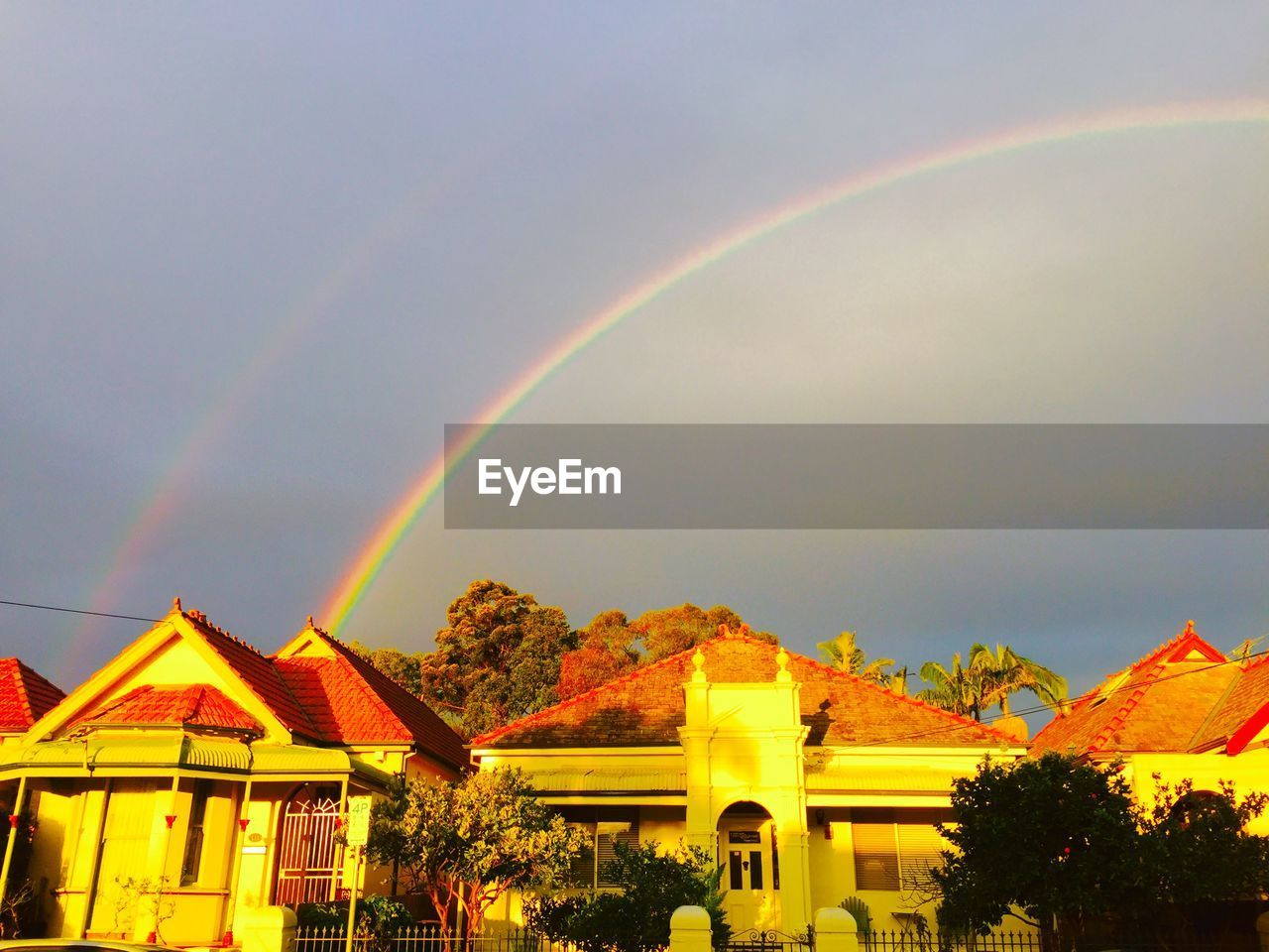 Beautiful view of double rainbow over houses