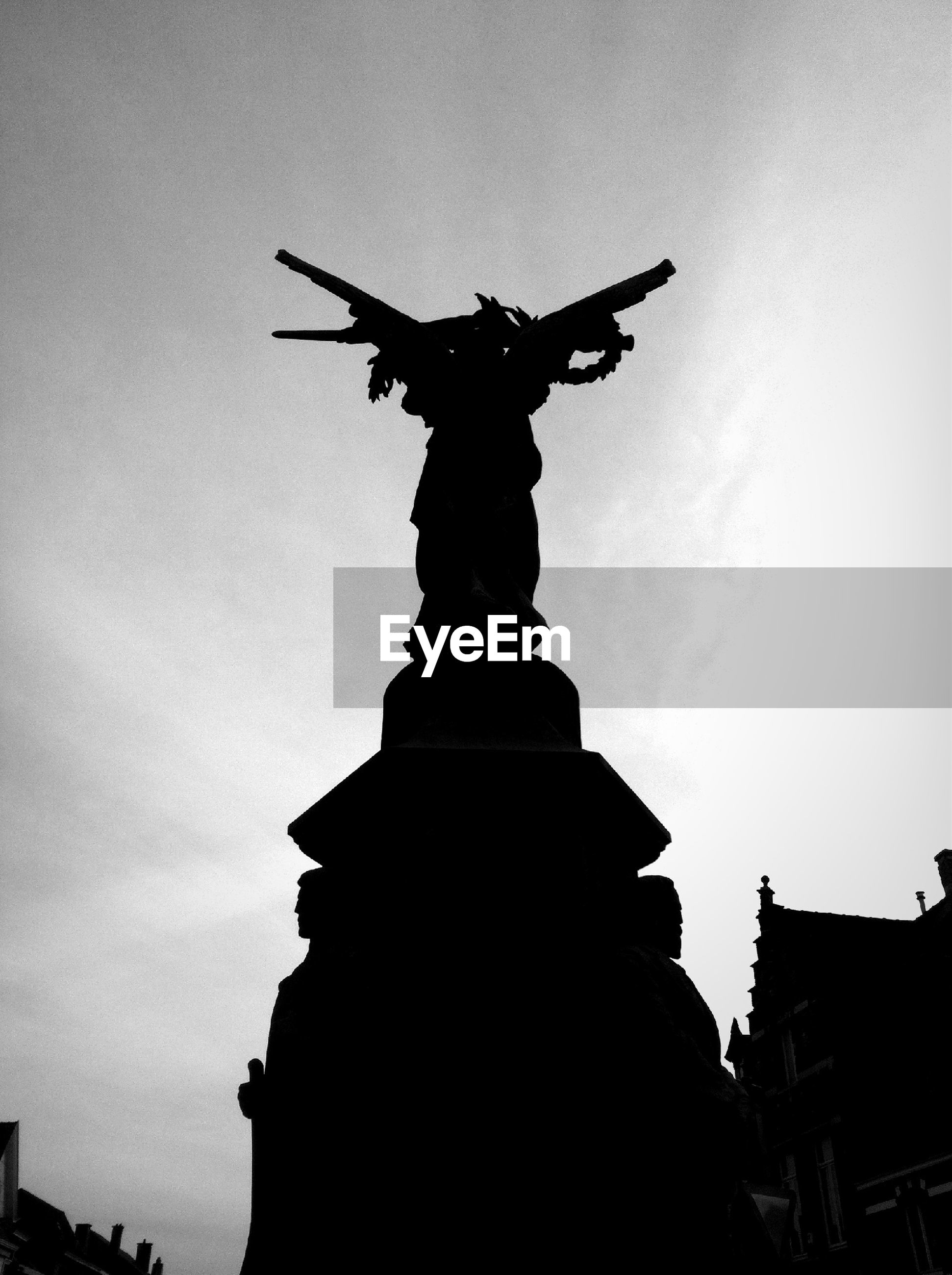 statue, sculpture, human representation, art and craft, art, creativity, low angle view, architecture, built structure, building exterior, sky, silhouette, monument, travel destinations, famous place, travel, religion, history