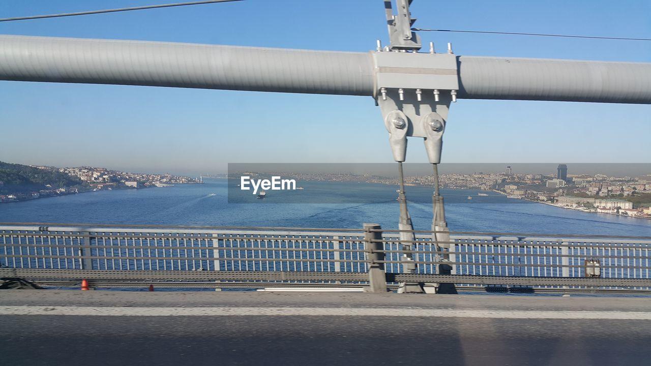 Bosphorus bridge over strait seen through car window