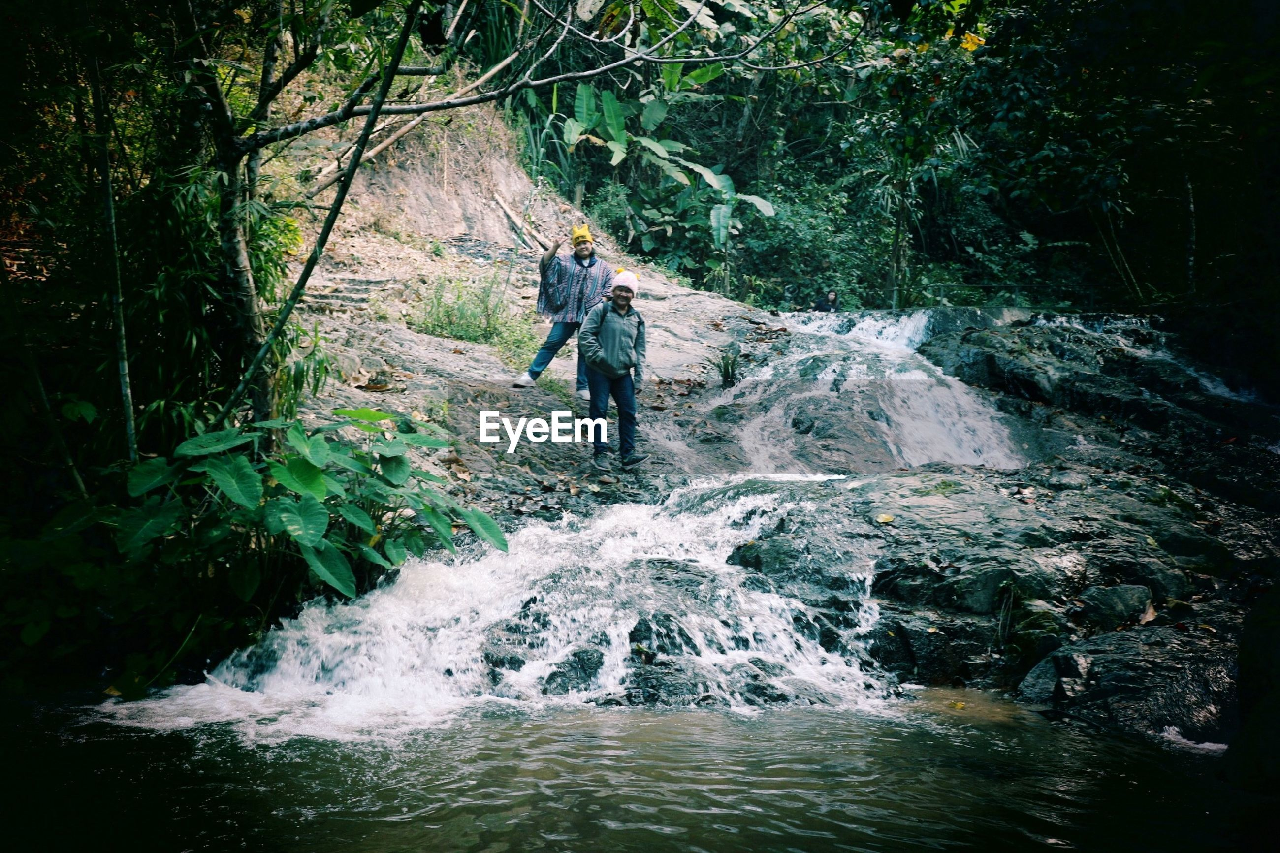 FULL LENGTH OF MAN ON RIVERBANK IN FOREST
