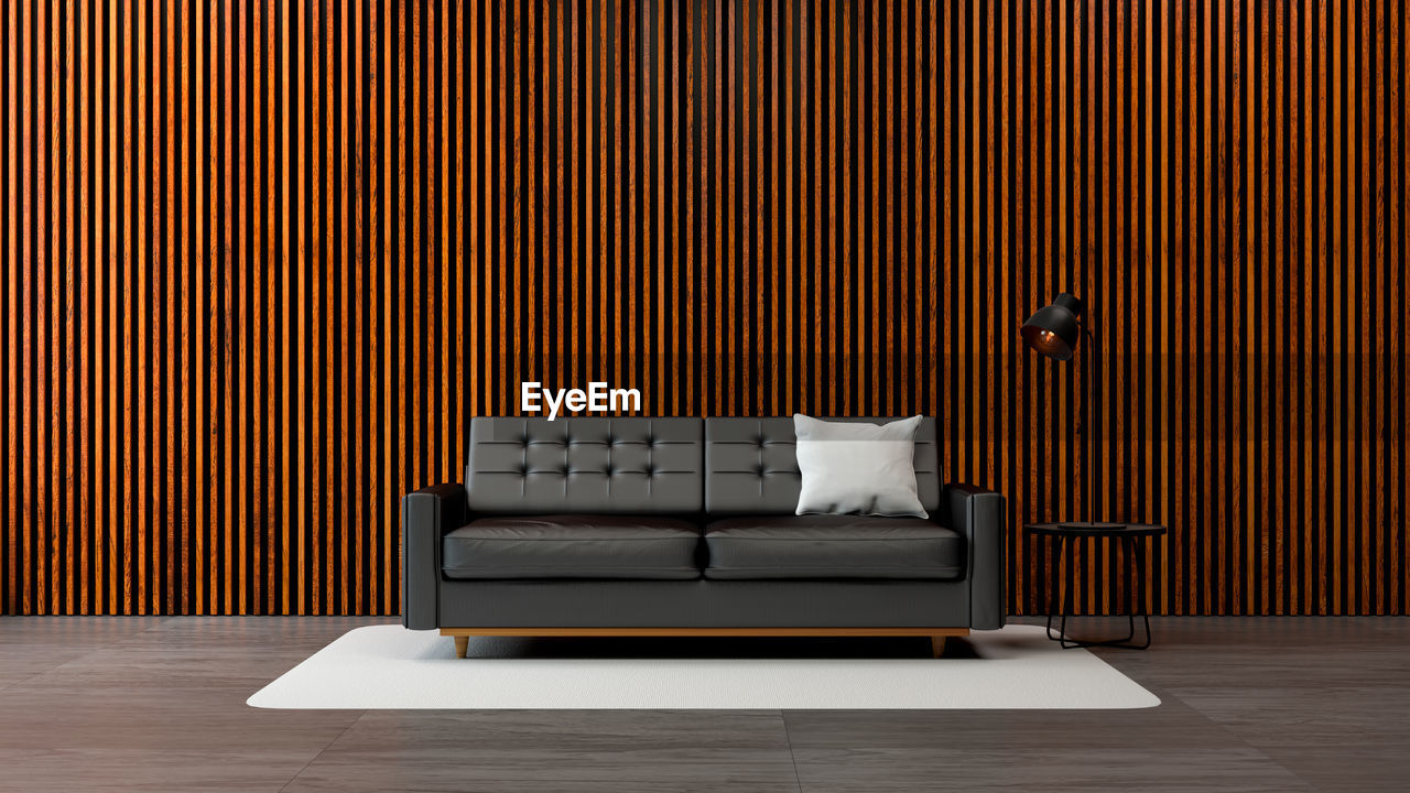 furniture, indoors, domestic room, sofa, pillow, no people, architecture, home interior, cushion, built structure, living room, flooring, relaxation, modern, stuffed, wall - building feature, building, bed, pattern, empty, luxury, apartment