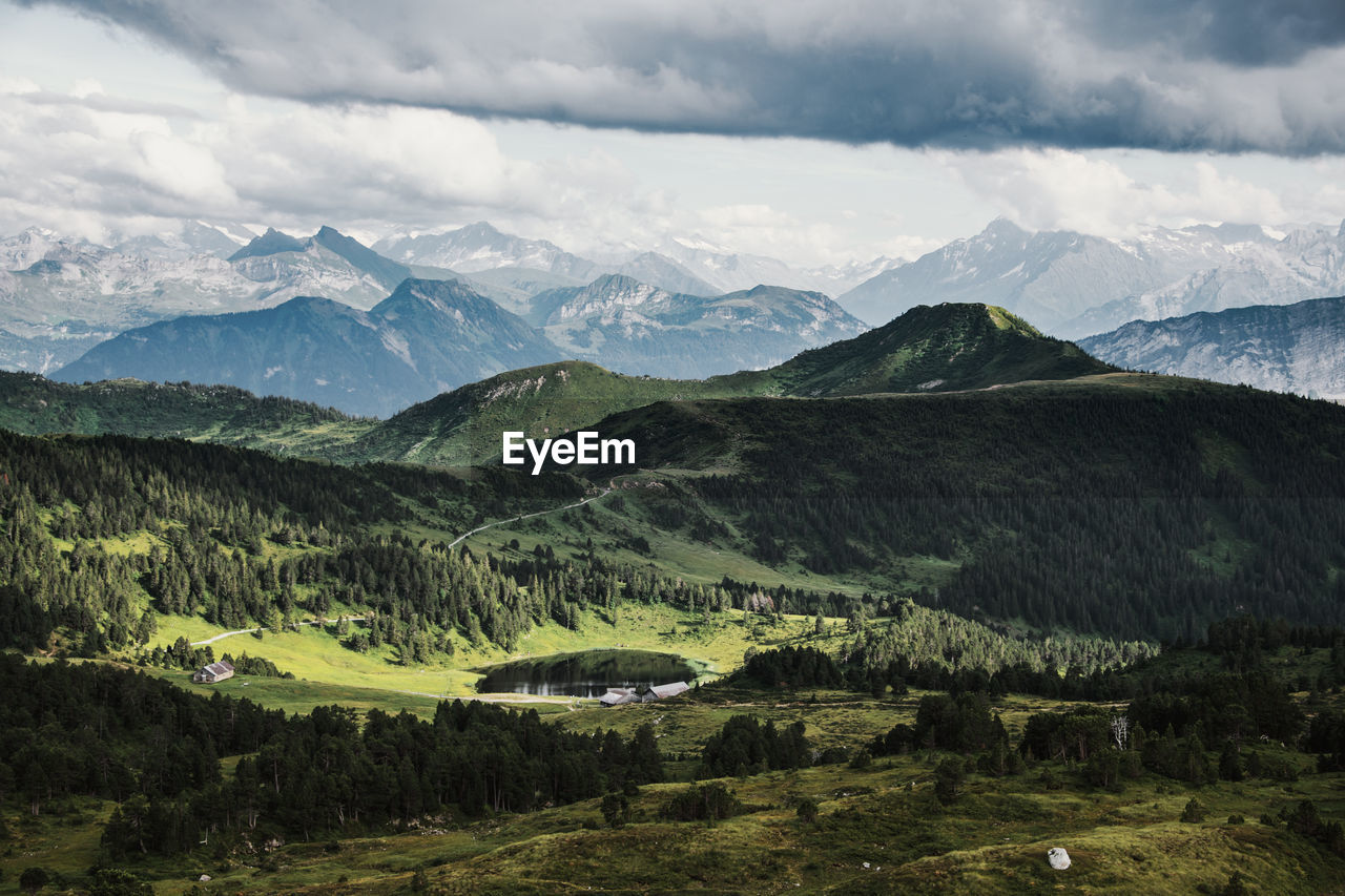 Scenic view of valley and mountains against sky