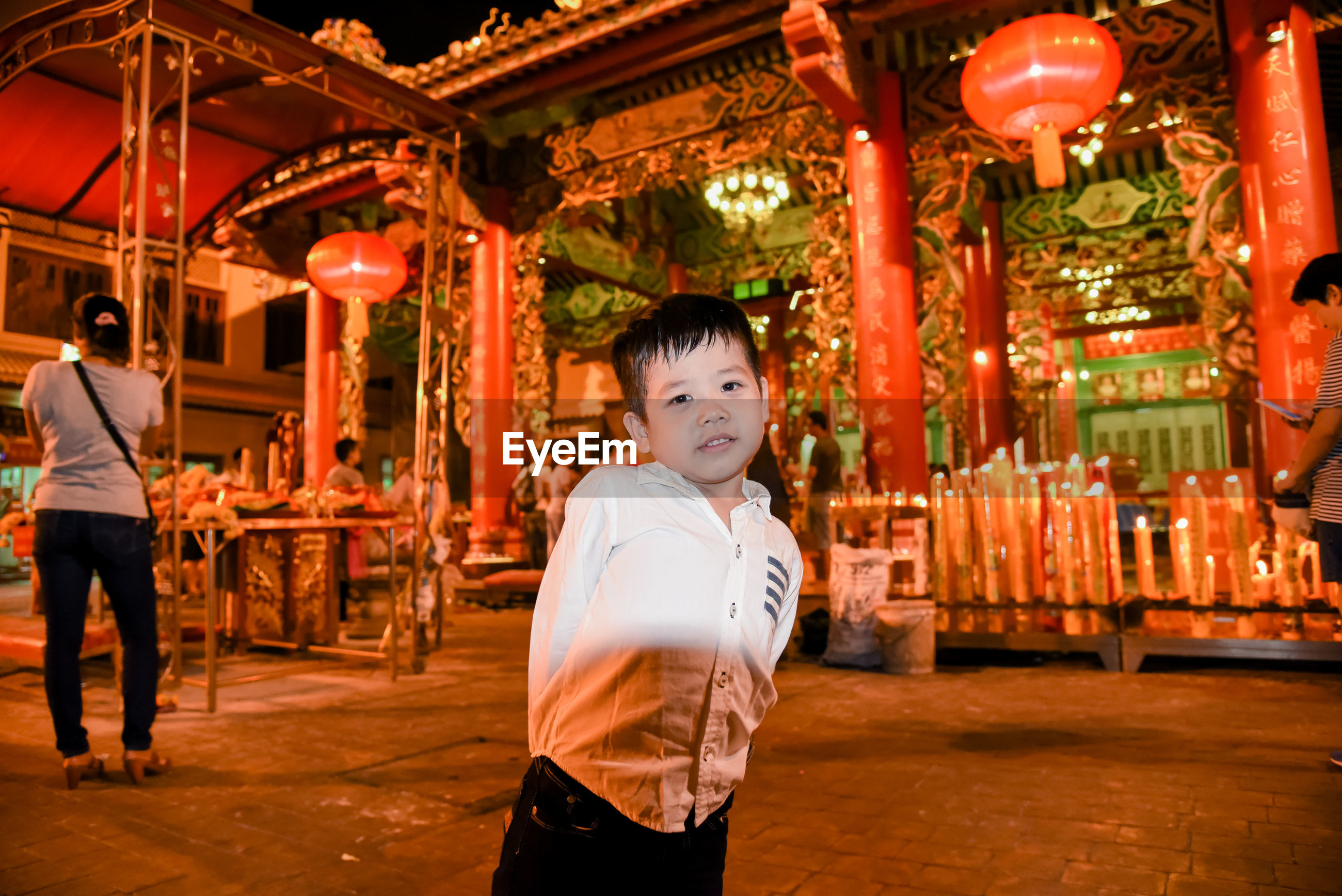 Portrait of smiling boy standing at temple
