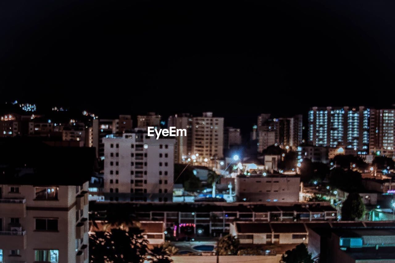 architecture, building exterior, night, illuminated, cityscape, city, built structure, no people, residential building, outdoors, modern, skyscraper, sky