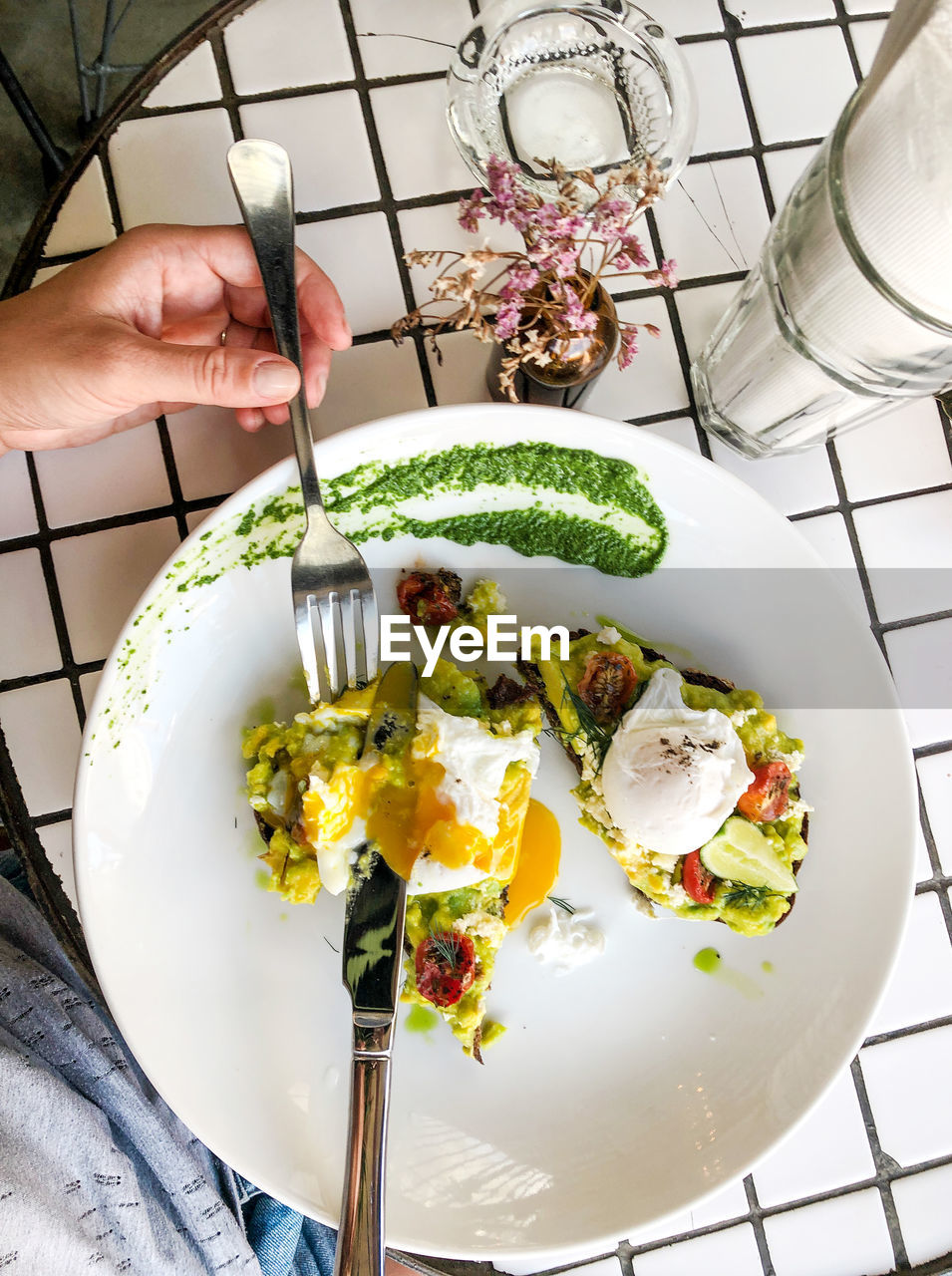 human hand, hand, food and drink, food, freshness, one person, indoors, holding, real people, human body part, healthy eating, plate, vegetable, kitchen utensil, high angle view, egg, unrecognizable person, ready-to-eat, lifestyles, preparation, finger, fried egg, preparing food