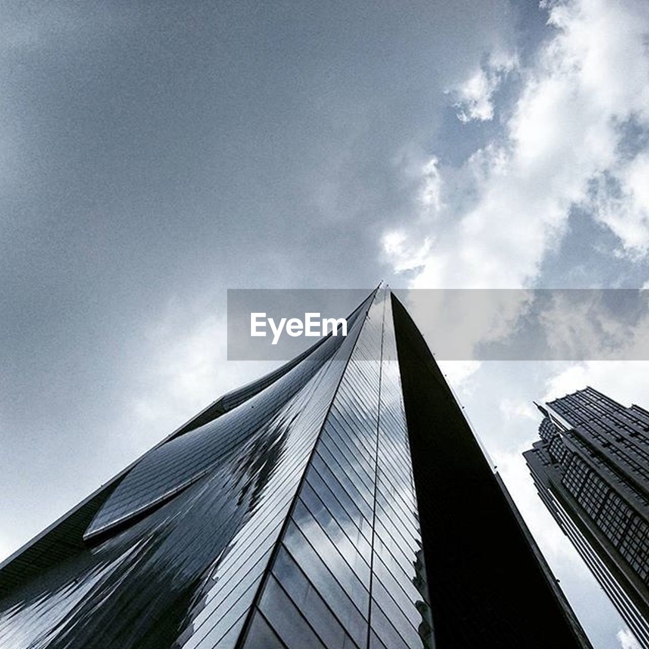 architecture, built structure, low angle view, building exterior, sky, skyscraper, modern, day, no people, outdoors, city, cloud - sky