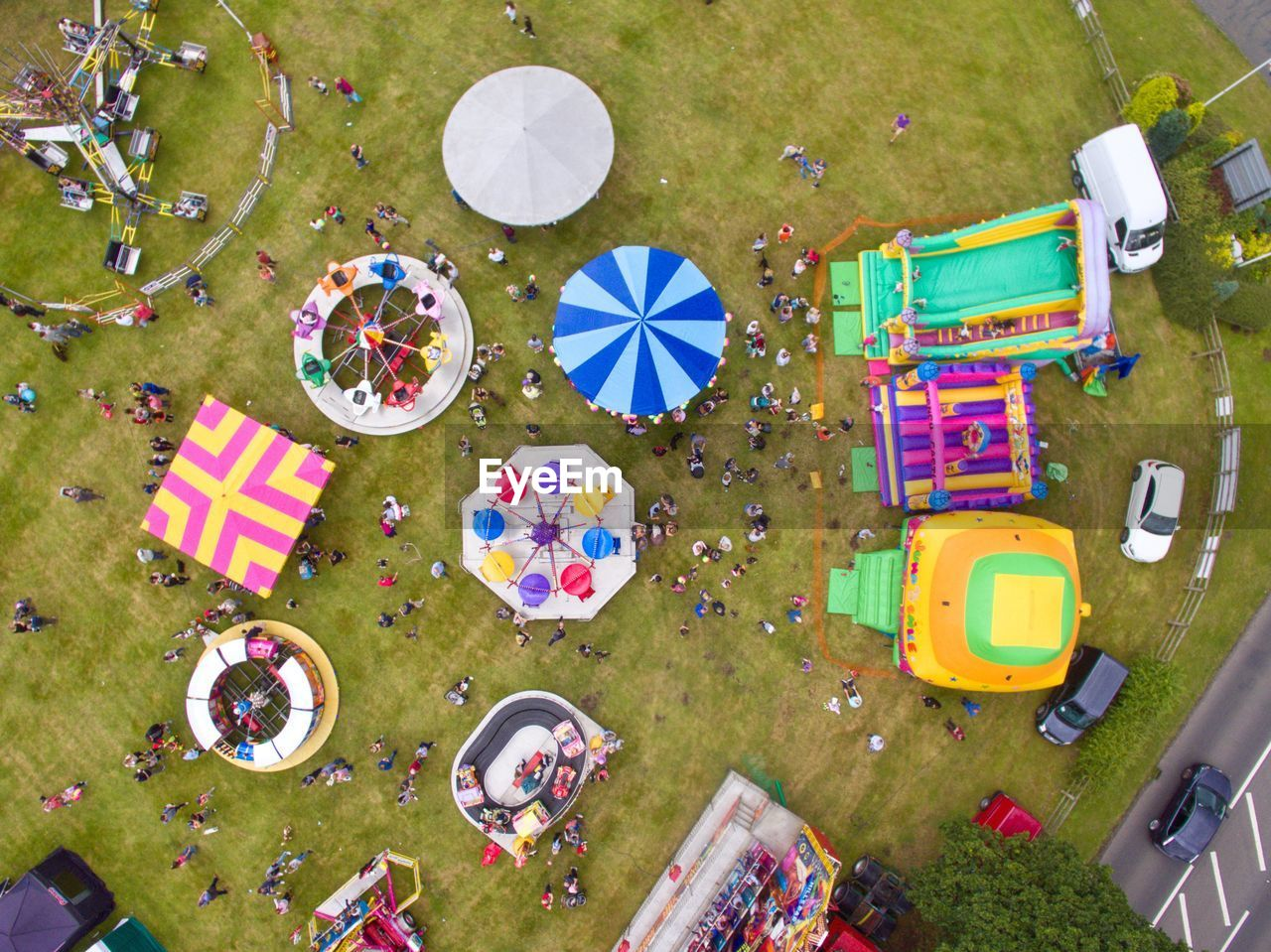 High Angle View Of Amusement Park Rides On Field
