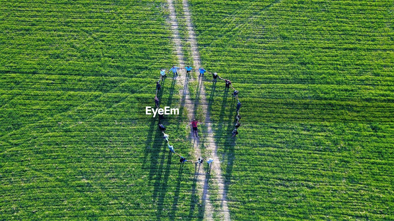 High Angle View Of Players Playing On Grassy Field