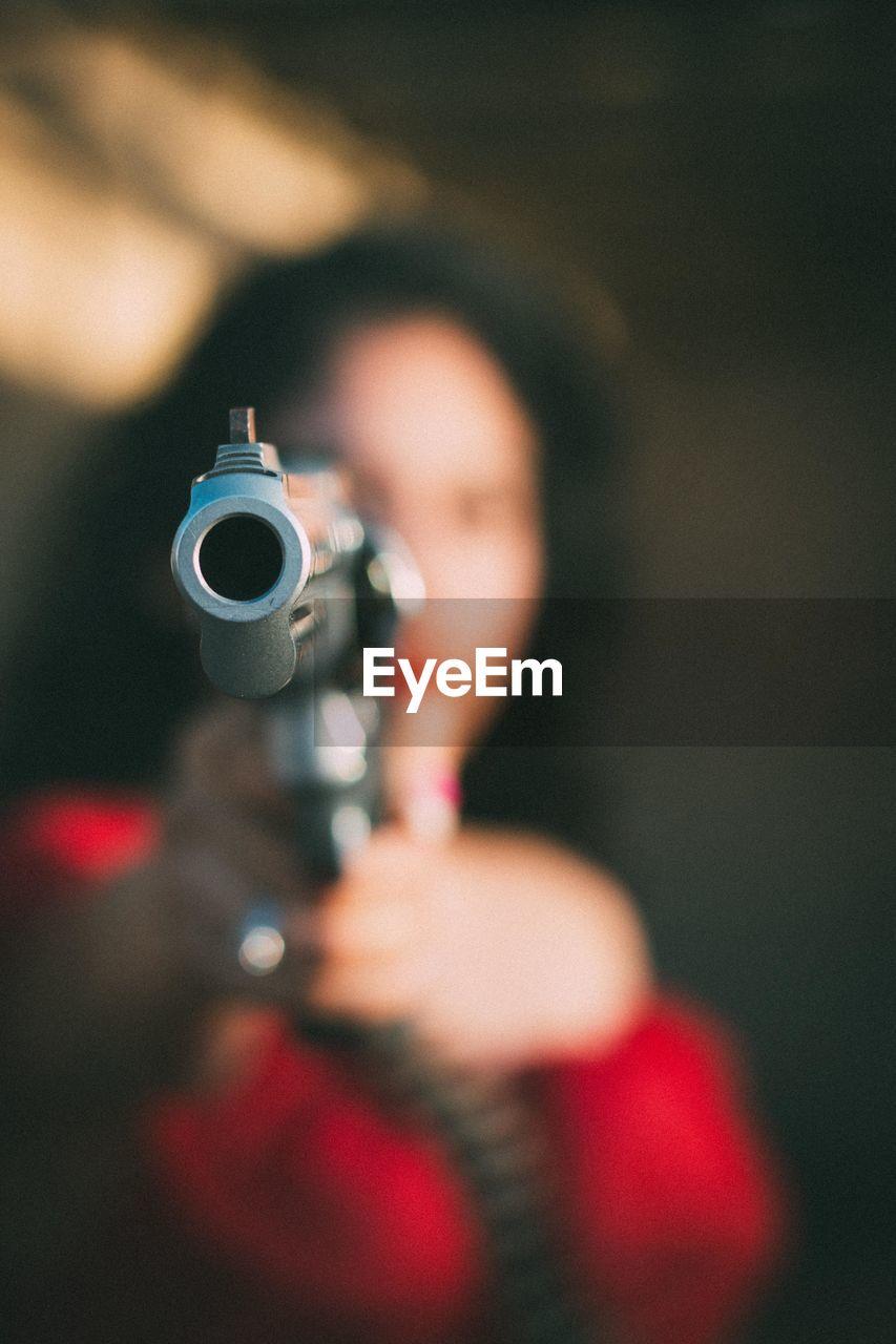 Blurred Woman Holding Gun