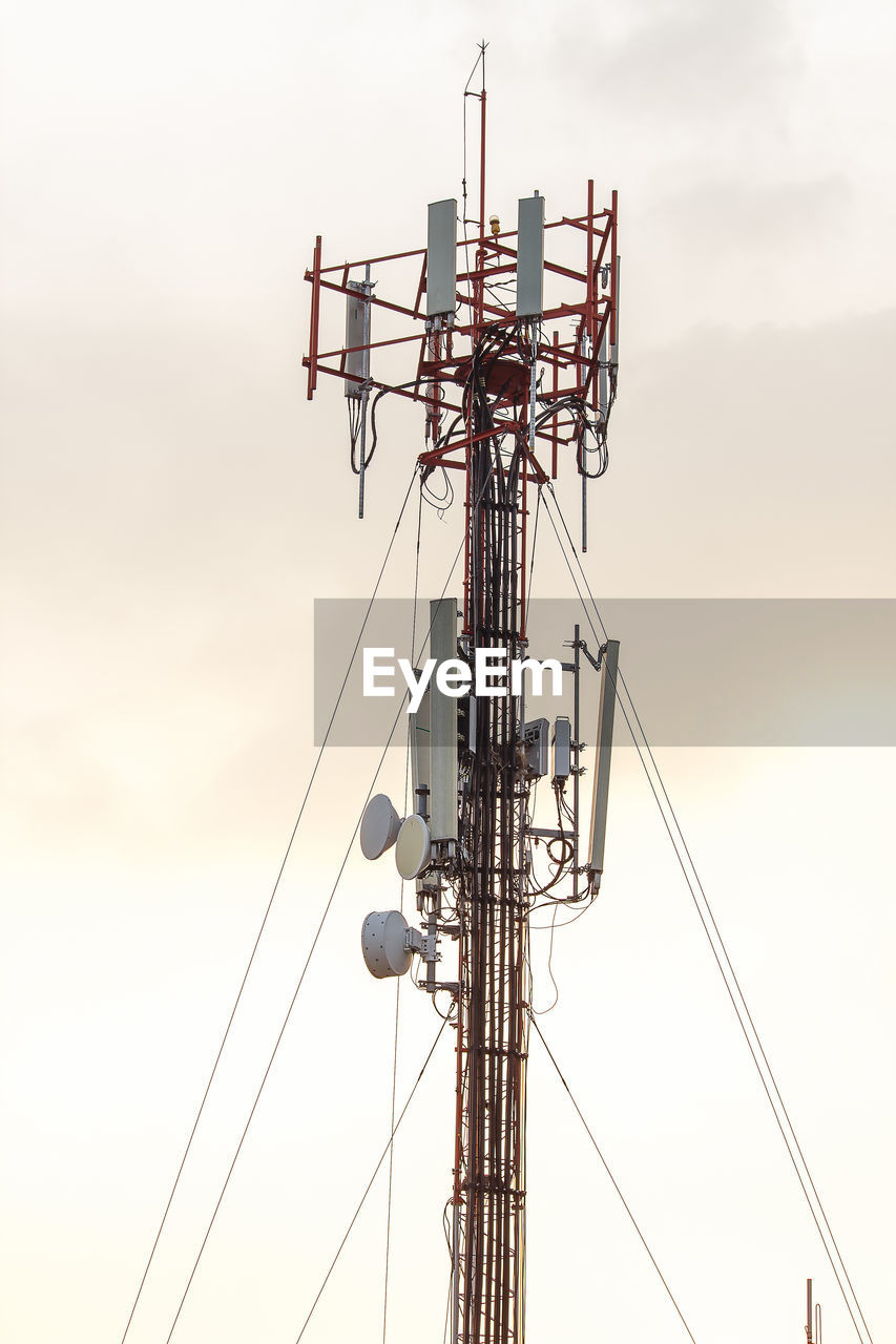 sky, technology, communication, sunset, low angle view, connection, no people, nature, outdoors, cloud - sky, antenna - aerial, cable, metal, tower, day, built structure, architecture, telecommunications equipment, electricity, satellite dish, global communications, power supply, electrical equipment