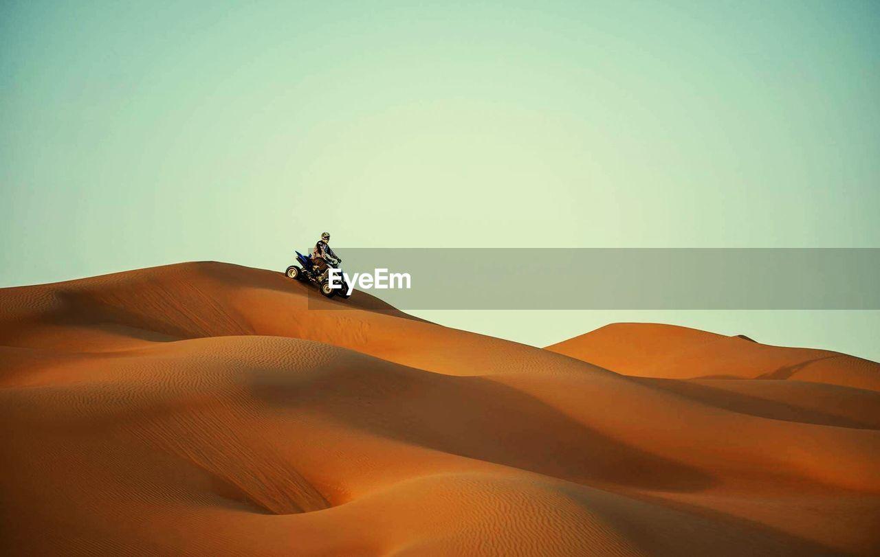 Man Riding Quadbike In Desert