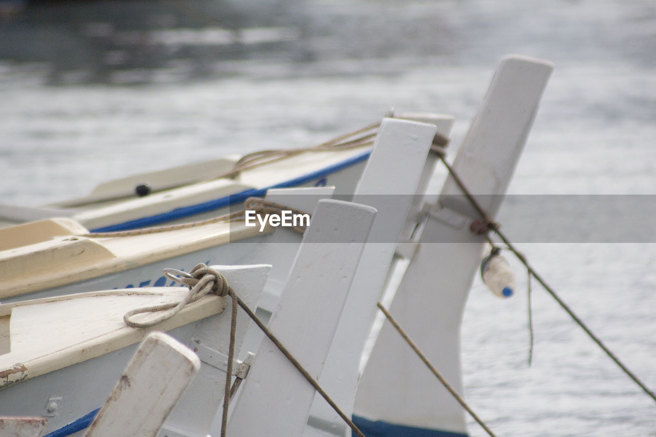 Cropped Image Of Boats Moored At Sea