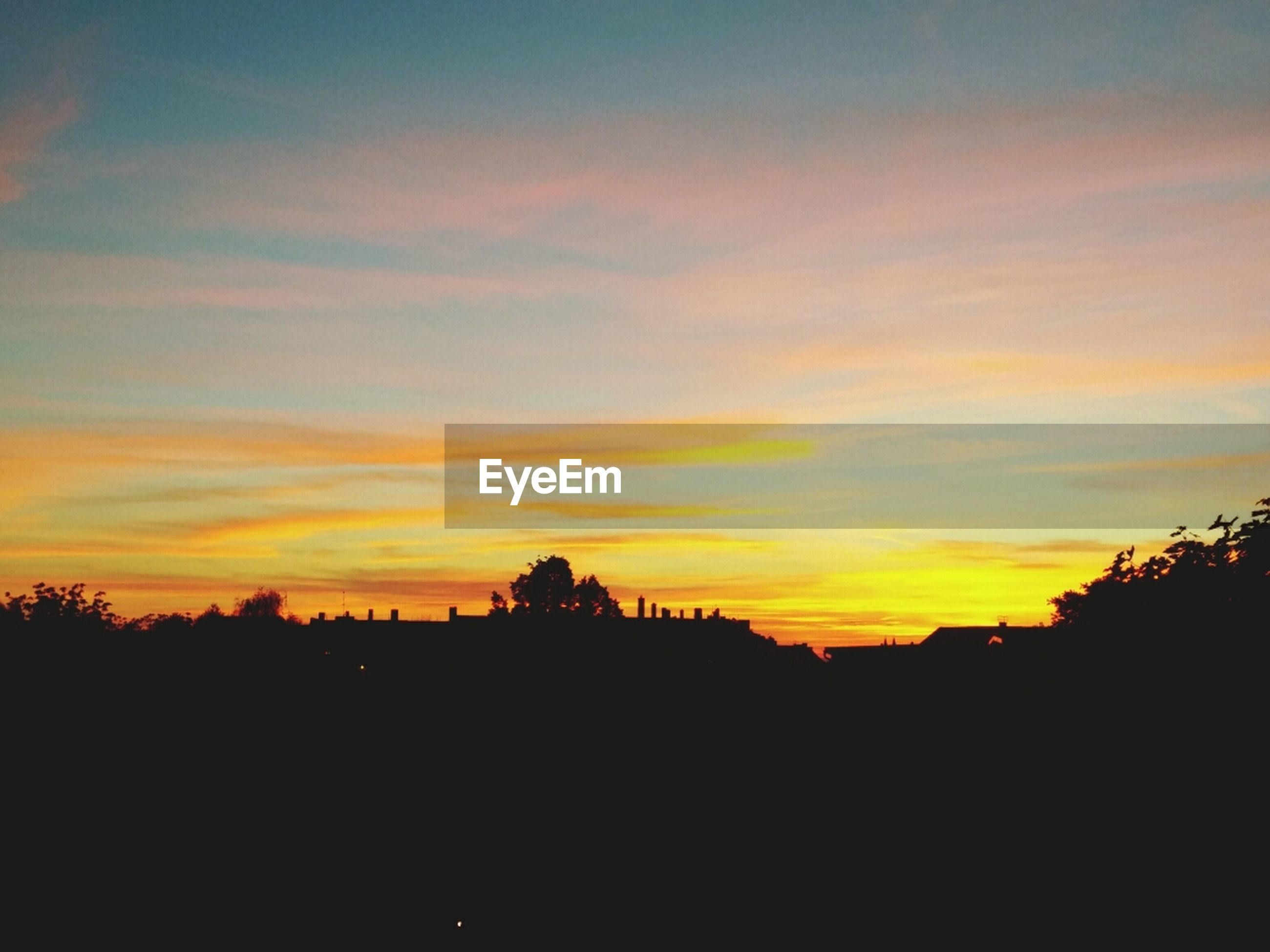 sunset, silhouette, sky, orange color, beauty in nature, scenics, tree, tranquil scene, tranquility, cloud - sky, nature, idyllic, landscape, built structure, outdoors, cloud, building exterior, no people, copy space, architecture