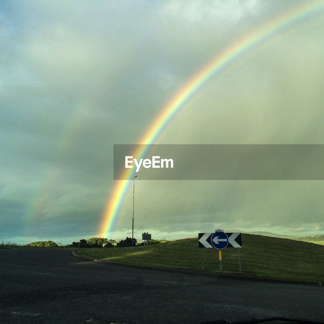 rainbow, double rainbow, sky, cloud - sky, landscape, scenics, day, beauty in nature, nature, weather, no people, field, outdoors, tranquil scene, tranquility, transportation, multi colored, storm cloud, grass, airplane