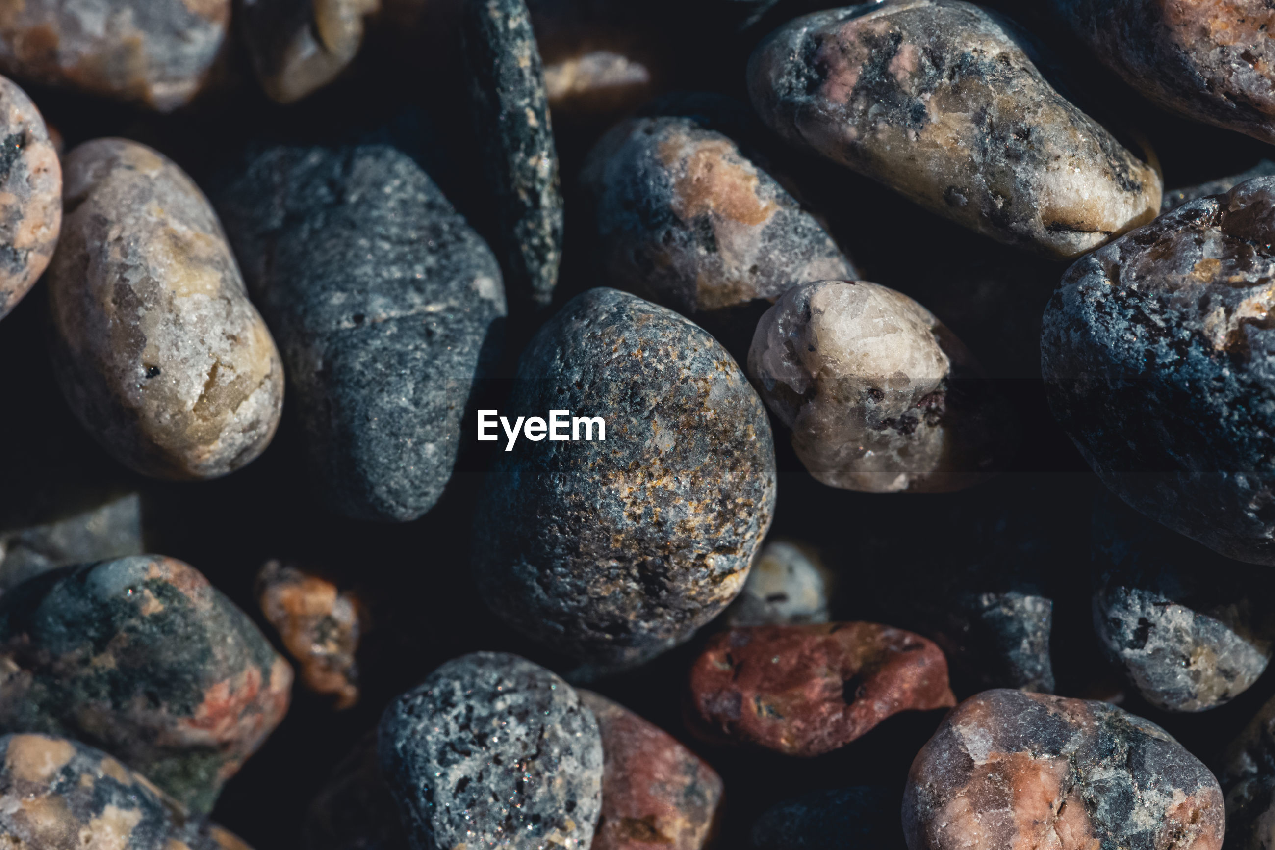 Full frame view of small pebbles on a beach