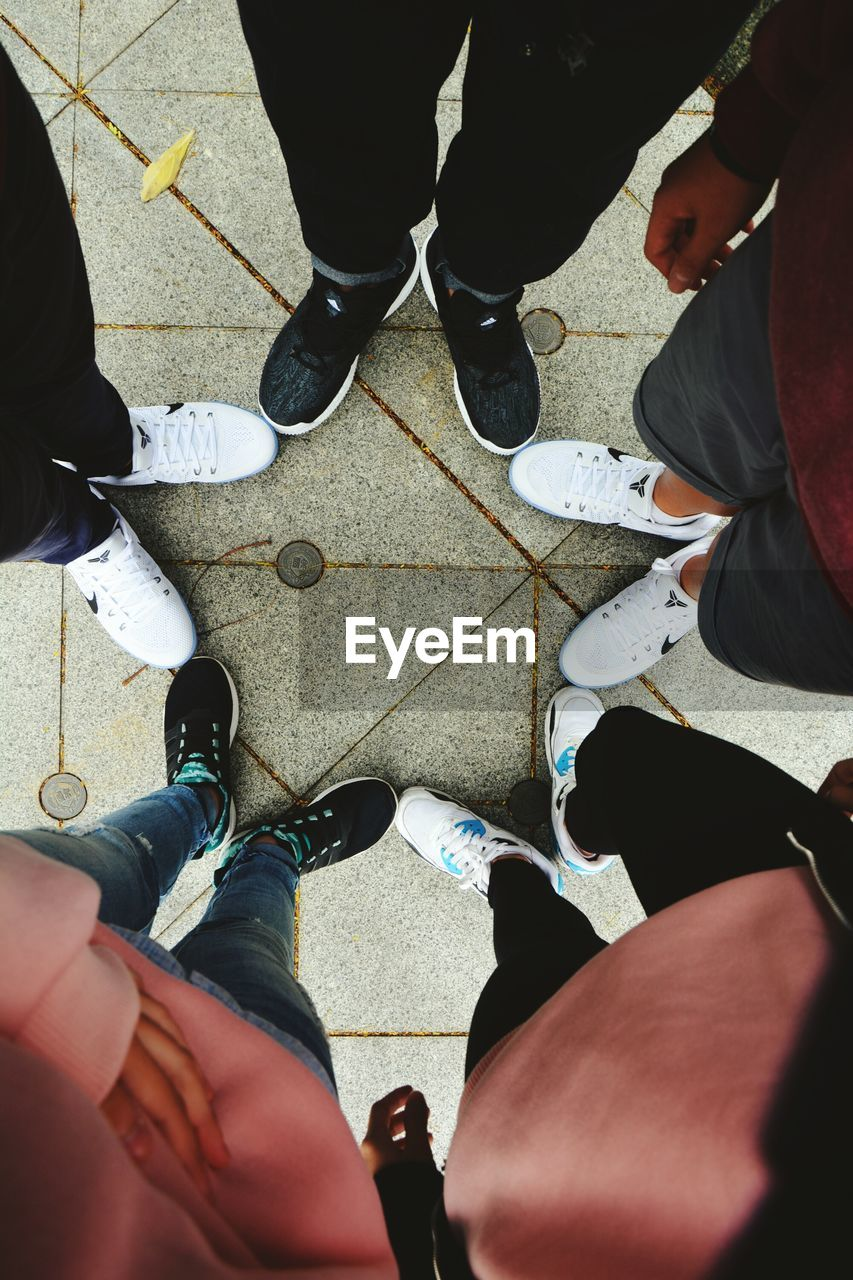 real people, standing, high angle view, low section, men, human leg, day, shoe, women, outdoors, road, lifestyles, human body part, adult, people