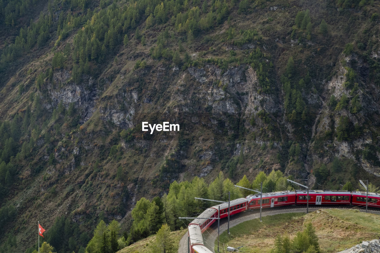 mountain, transportation, mode of transportation, connection, bridge, scenics - nature, day, bridge - man made structure, nature, plant, road, architecture, mountain range, no people, non-urban scene, built structure, motion, water, outdoors, environment