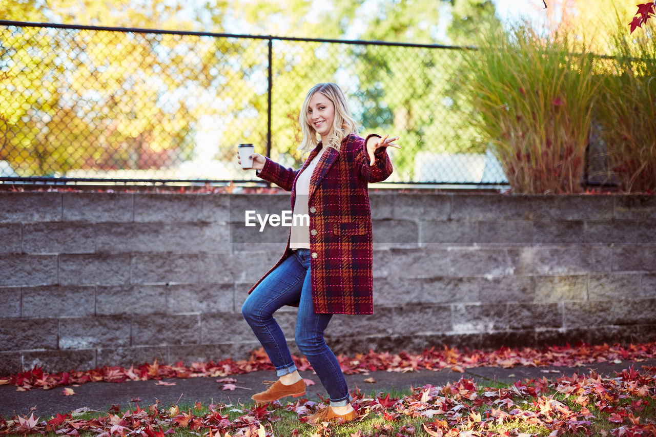 Young Woman Walking At Park During Autumn
