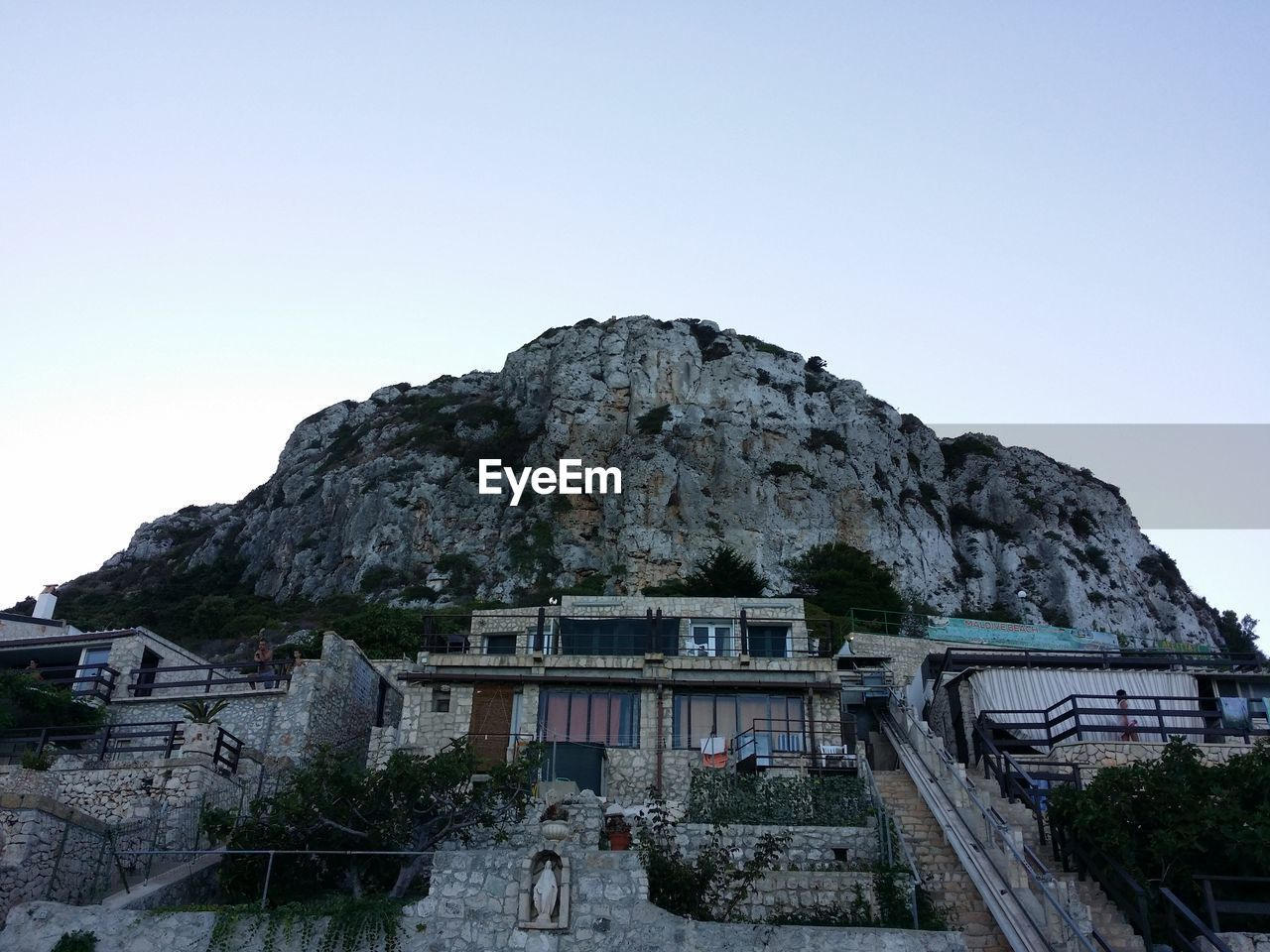Low Angle View Of Built Structure Against Mountain