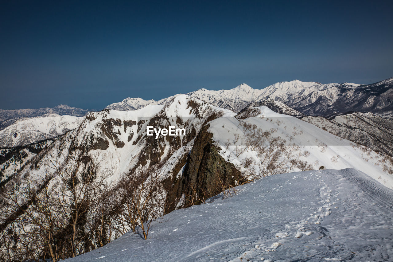 cold temperature, snow, winter, beauty in nature, mountain, sky, tranquil scene, tranquility, scenics - nature, mountain range, non-urban scene, snowcapped mountain, environment, landscape, no people, clear sky, day, nature, white color, mountain peak