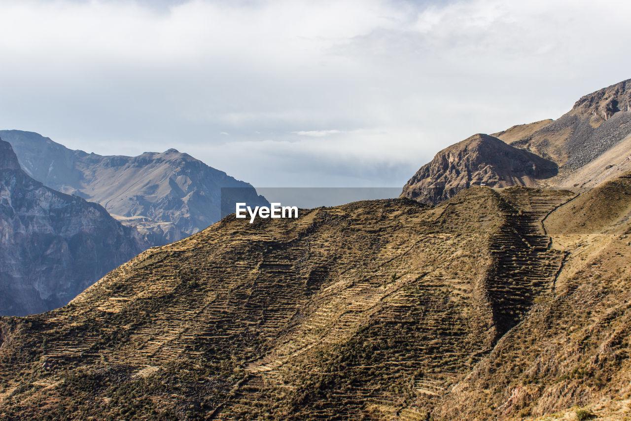 mountain, sky, nature, landscape, mountain range, outdoors, beauty in nature, day, no people, peak, scenics, scenery, range