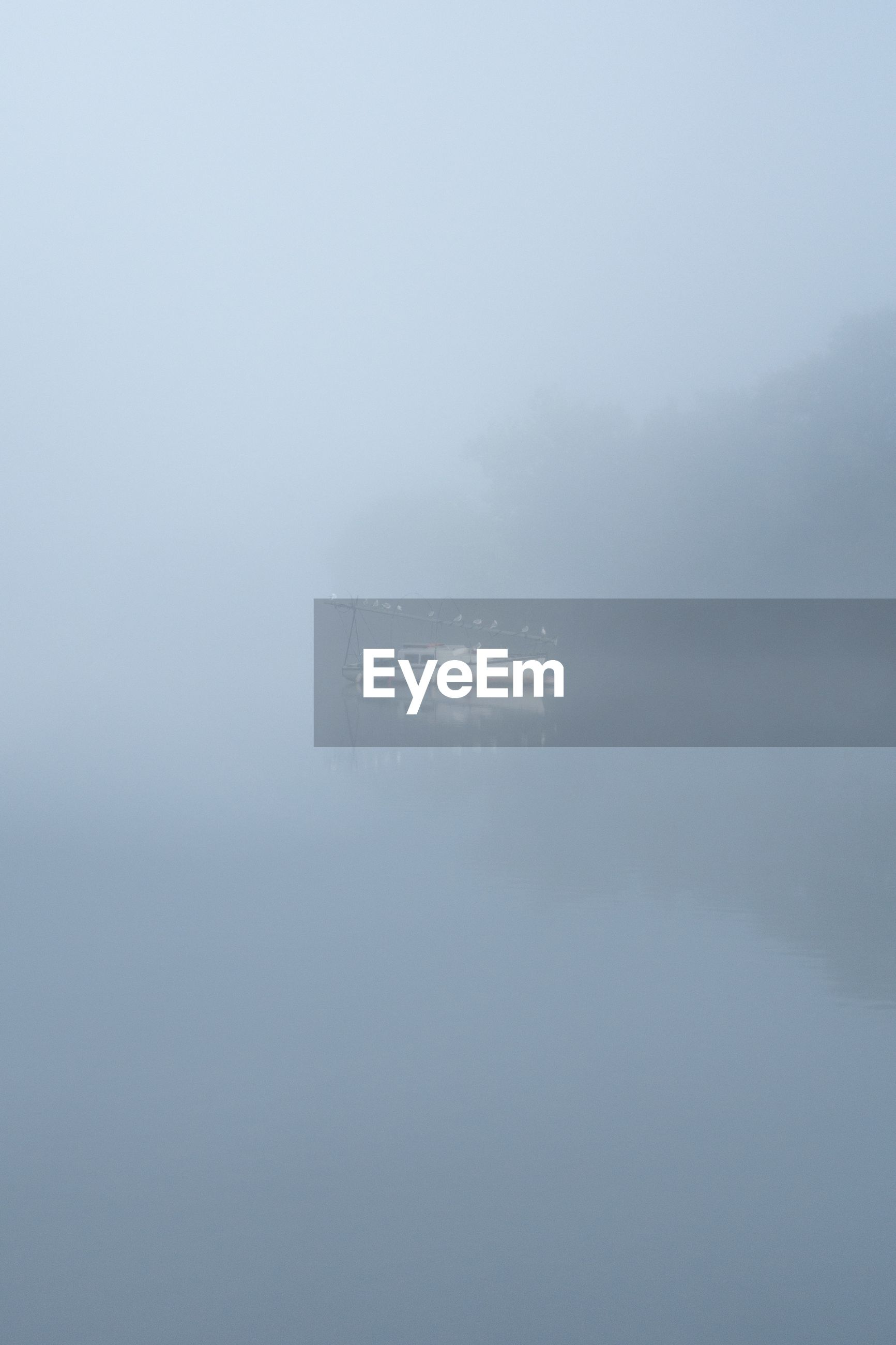 fog, water, scenics - nature, beauty in nature, tranquil scene, tranquility, waterfront, lake, nature, idyllic, cold temperature, non-urban scene, no people, winter, day, hazy, sky, reflection, outdoors, climate