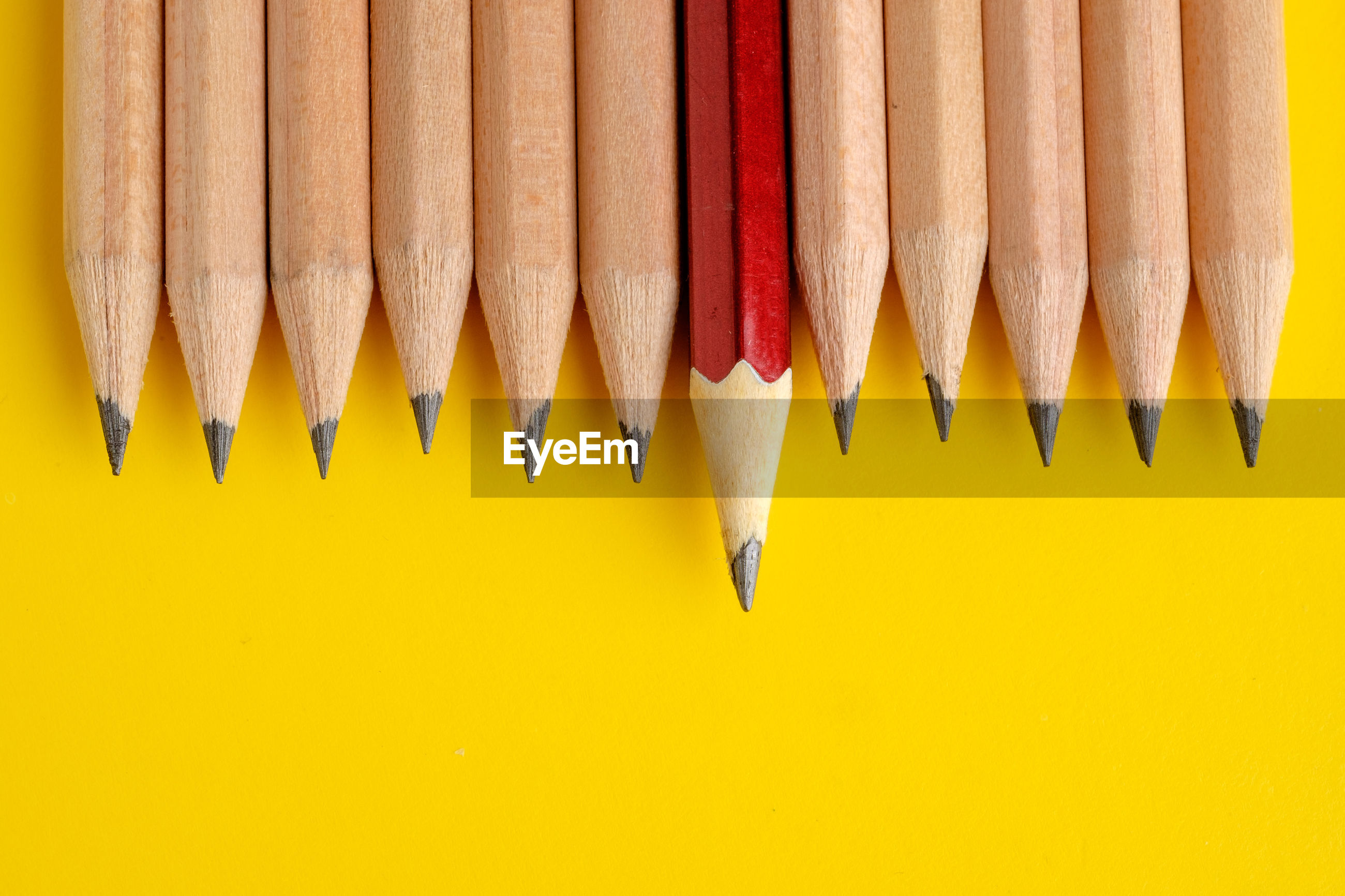 Directly above shot of pencils on yellow background