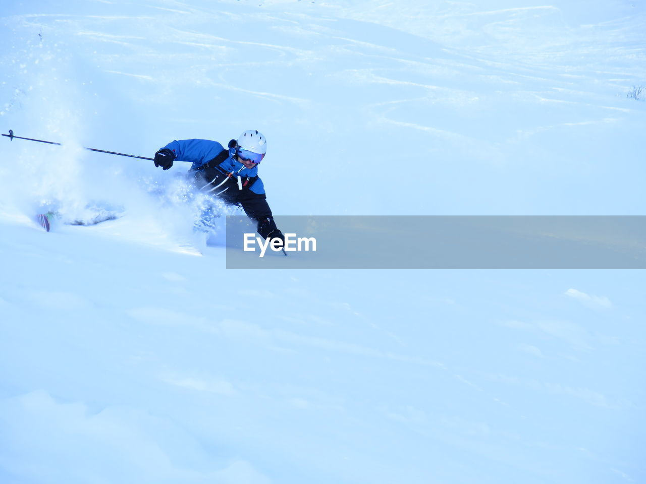 Man skiing on snow covered hill