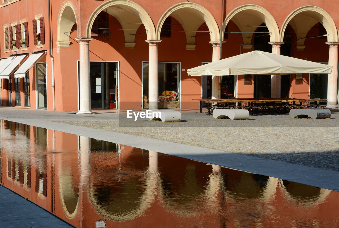architecture, water, built structure, building exterior, building, reflection, arch, nature, day, no people, outdoors, transportation, window, waterfront, mode of transportation, city, luxury, sunlight, parasol, swimming pool, architectural column