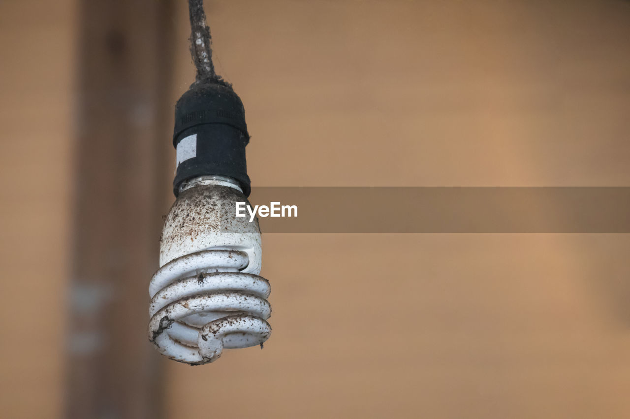 focus on foreground, close-up, hanging, no people, day, metal, outdoors, low angle view, wood - material, nature, rope, selective focus, built structure, architecture, still life, wall - building feature, pattern, spiral, string, strength